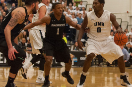 UNH men's basketball player driving to the hoop