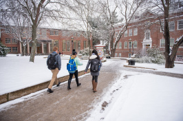 Students walking on the University of New Hampshire campus during winter season