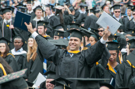 Members of the UNH Class of 2015 celebrate at their commencement