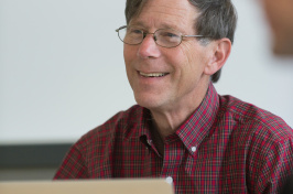 UNH professor David Finkelhor sits in front of  a laptop