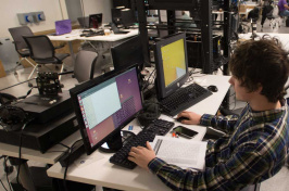 A student working on a computer at UNH's IOL