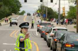An officer directing traffic at UNH