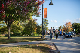 Students at a busy intersection on UNH campus