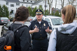 UNH police chief Paul Dean talking with students