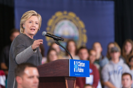 Hillary Clinton speaking at the UNH field house