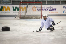 UNH/Northeast Passage sled hockey player
