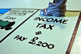 "image of ""income tax"" stop on Monopoly board"