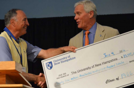 UNH President Mark Huddleston receiving a ceremonial check for the university from the class of 1966