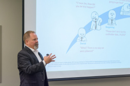 Todd Waskelis, vice president of AT&T Security Solutions, gives a presentation on how to address cyber threats at the Paul College Cybersecurity Symposium.
