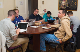 UNH veteran-students in the veteran-student lounge in Thompson Hall