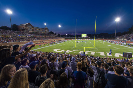 fans cheering during the first football game at UNH Wildcat Stadium