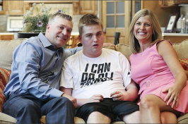 Brian Long, left, and Kim Long, right, with their son Brennan Long last year. Brennan was left with two shattered thigh bones after being restrained by a staff member in his Louisville school in 2014. —Sam Upshaw Jr./Louisville Courier-Journal-File
