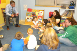 John Bragg, president of N.H. Bragg and Sons, reads a book to students at the Head Start Center at Eastern Maine Community College in a 2011 file photo.