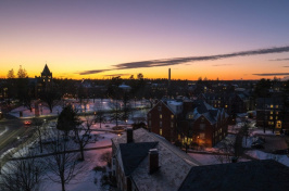 aerial view of UNH's Durham campus at sunset during winter