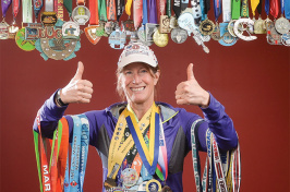 UNH alumna Kathy Stickney '86 with running medals