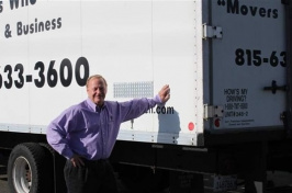 Mover Bob Christensen of Loves Park, Illinois, beside one of his trucks.
