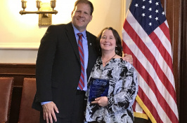 UNH IOD's Therese Willkomm with NH Gov. Chris Sununu