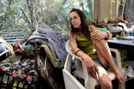 Billie Jo leans back at her homeless encampment on Bureau of Land Management land near unincorporated Cameron Park in El Dorado County, CA