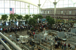 airport security line, photo by KITT HODSDEN; WIKIMEDIA COMMONS