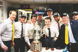 Manchester native Mat Myers, to the right of the Campbell Trophy, poses with Nashville Predators staff and coaches including head coach Peter Laviolette, to the left of the trophy. (COURTESY)