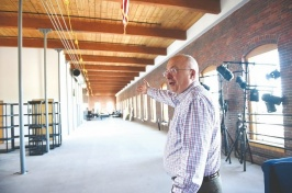 Mike Decelle, dean of the University of New Hampshire-Manchester, gives a tour of the top floor of the old Pandora building in Manchester (DAVID LANE/UNION LEADER)