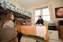 Two girls sitting in dorm room at UNH