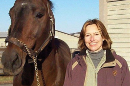 UNH alumna Susan J. Bruns '78 '95G with a horse