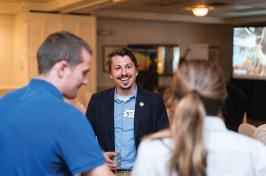 UNH alumni talking at a NH Lakes Region event