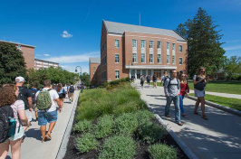 students walking near UNH's Paul College