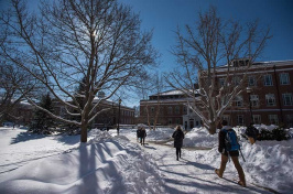 UNH students walking through a snowy campus