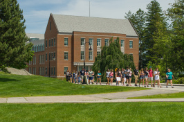 UNH campus with students walking along path