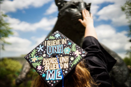 wildcat statue and UNH graduate