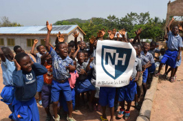 Students in Africa show their UNH pride