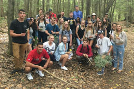 group of students posing in College Woods