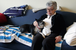 Elizabeth Kennedy pets her dog, Dolly, in her living room at TigerPlace, a retirement community in Columbia, MO.