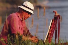 UNH alumnus Arthur Richard DiMambro '51 painting outdoors
