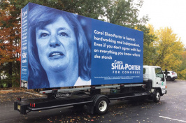 a large Carol Shea-Porter campaign sign on a truck