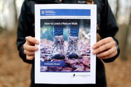 image of volunteer holding training guide