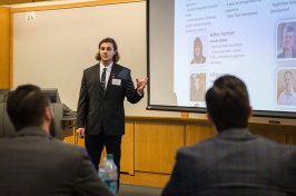 a UNH student presents to judges during the Paul J. Holloway Innovation to Market Competition Challenge Round