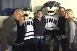 UNH Paul College graduate Kevin Knarr and others at a UNH hockey game