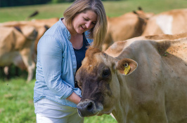 Kristin Duisberg visiting some cows at the UNH organic dairy
