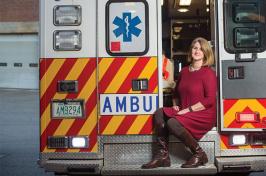 Kristin Duisberg sitting on the back of a McGregor EMS ambulance