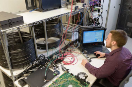 a student working at a computer in the UNH Interoperability Laboratory or IOL