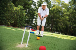 UNH alumnus Bert Myer '67 playing croquet
