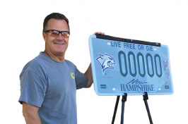 UNH parent Peter Spain with a UNH license plate