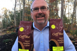 UNH organic chemist Glen Miller with CoffVee Heart Healthy Coffee bags