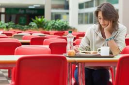 A girl sitting alone during lunch (Wavebreakmedia Ltd/Thinkstock)