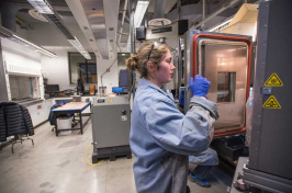 UNH student Kate Haslett '18 stress testing asphalt in a Kingsbury lab