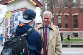 UNH president Mark W. Huddleston talking to a student