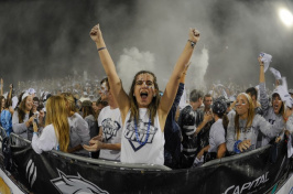 Hailey Simpson '18 cheering in the student section at a UNH football game